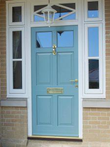 Polished Brass door handle, letter plate, 'doctor' door knocker and decorative escutcheon.