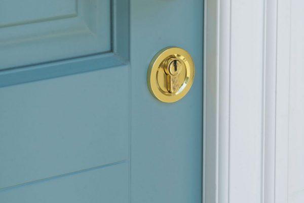 decorative key hole cover on a light blue door