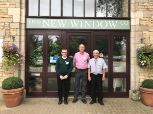 new window company sales team stood outside the showroom
